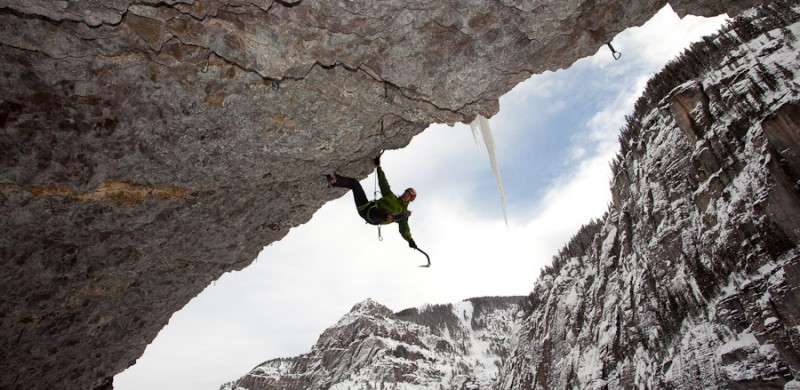 A climber dangles from a roof in the San Juan mountains near Ouray, Colorado.